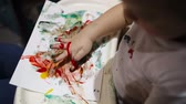 finger painting : Little boy painting with colorful finger-paints. Activity for children.