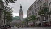 real jam : Cityscape with City hall, Rathaus. City traffic and pedestrians.  Stock Footage