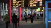 tallin : TALLIN, ESTONIA - MAY 25, 2014: People walking on Central bus station with digital display with routes above Stock Footage