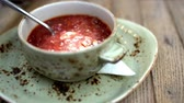 borscht : Close-up shot of stirring up sour cream in borsch served in cafe or restaurant Stock Footage