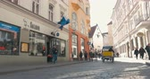 bike ride : TALLINN, ESTONIA - APRIL 27, 2015: Steadicam shot of moving along the street with old buildings of classical European architecture on sunny day. People walking and bike taxi riding there