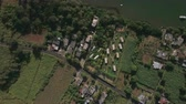 strand road : Aerial top view of countryside district, agricultural fields, streets with traffic cars, roofs of houses, forest