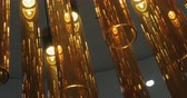 interior design : Lighting design with tube lamps made of brown glass Stock Footage