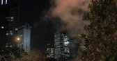 mystický : Tel Aviv night cityscape with high-rise buildings and condensing steam