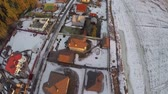 havasi levegő : Flying over private houses and snowy farmland in small Russian township. Winter scene