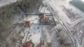 havasi levegő : Aerial scene of cottages in the countryside and winter panorama with woods and vast snowy fields, Russia