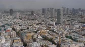 high rise buildings : Cityscape of built-up Tel Aviv in daytime. View of densely populated city with numerous houses and skyscrapers, Israel Stock Footage