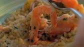 アントレ : Close-up shot of eating risotto with prawns and squid. Dining in sea food restaurant
