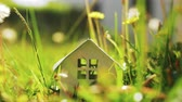 mecaz : Small house model among green grass. Living in the countryside and eco-home concept, real estate