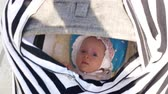 младенец : Mother pushing pram to lull the baby. Girl in bonnet looking from inside and isnt going to sleep to sleep Стоковые видеозаписи