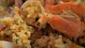étvágygerjesztő : Close-up shot of having meal with risotto. Sea food dish with shrimps and squid