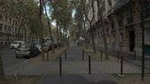 astarlı : PARIS, FRANCE - SEPTEMBER 29, 2017: Timelapse shot of walking on tree lined sidewalk along the street in autumn. Coming to the crossroad with view to Eiffel Tower Stok Video