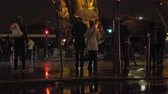 předpis : PARIS, FRANCE - SEPTEMBER 29, 2017: People with umbrellas standing at crosswalk near Eiffel Tower and waiting for green traffic light to go. Rainy night in the city
