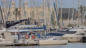 dokk : ALICANTE, SPAIN - APRIL 19, 2018: Many yachts moored in city quay, Spanish flag on vessels flattering in the wind