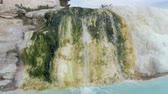 brook : Travertine creek with water flowing and falling in hot water springs in Pamukkale, Turkey