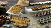 kararlar : Steadicam shot of walking along the buffet table with variety of appetizing desserts. Hotel catering Stok Video
