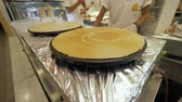crepe : Street snack bar. View to the ready golden crepe and working cook Stock Footage