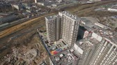 gayrimenkul : Flying over residential compound being under construction with one finished apartment block, spring view. Moscow, Russia Stok Video