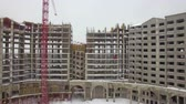 郊外の : Aerial shot of multistorey apartment complex under construction. Winter view, Russia 動画素材