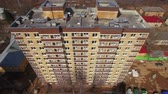 郊外の : Aerial shot of new highrise apartment block with following view to the community with private houses, Russia 動画素材