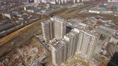 apartment buildings : Aerial shot of modern highrise apartment complex under construction near the railroad, spring view. Moscow, Russia