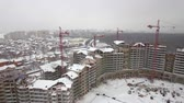 multistory : Aerial shot of winter city suburbs and apartment complex being under construction, Russia