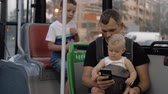 vader : Dad riding in the bus with elder son and one year old baby daughter. Everyone watching fathers smart phone