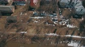 banlieue : Aerial shot of township with houses and apartment block, Russia. Spring view with some snow left