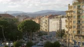 транспорт : Cityscape of Savona in bright sunshine. Street with green trees and car traffic