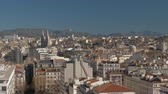 住居 : Panoramic view of Marseille, France. City architecture with Saint Vincent de Paul Church and green hills in background 動画素材