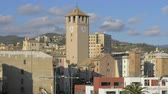 clock : Savona cityscape with Torre del Brandale and green hills in background, Italy