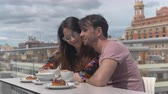 honey moon : A young sweet couple having kiss and dessert in an open cafe overlooking the old Valencia