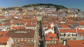 ascenseur : Looking at Lisbon with its typical brown roofs houses, Saint George Castle and Rua de Santa Justa from the observation deck of the famous city lift Vidéos Libres De Droits