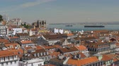 lisboa : City scene with houses, Lisbon Cathedral and barge in the river. View from Santa Justa Lift, Portugal