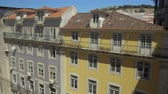 точка зрения : Lisbon cityscape with houses, chaise longues on the rooftop and old Santa Justa Lift, popular tourist attraction. Portugal Стоковые видеозаписи