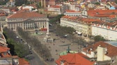 lisboa : Cityscape of Lisbon in Portugal. Scene with people walking at Rossio Square with the Column of Pedro IV in the middle Stock Footage