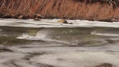 söprés : Strong wind gusts race over the icy waters of the Poudre River in Colorado.