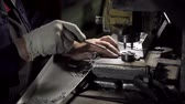 zinco : Machine and workers hands close-up in factory Stock Footage