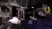 zinco : Machine operator works in a factory and stamps metal products Stock Footage