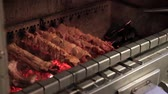 commercialkitchen : The chef roasts grilled various kinds of meat over charcoals in the restaurant.