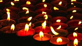 symbol of respect : slow pan up of fire on candle background for worship Lord Buddha