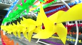 pinwheel : yellow windmill toy is decorated at shopping mall to welcome summer1 Stock Footage