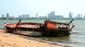 vento : Wrecked fishing boats on the beach due to storms blowing