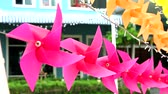 pink windmill toy is decorated in front of shopping mall to welcome summer
