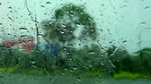 parabrezza : view inside car, driver parking car beside road because rain drop heavy storm wind