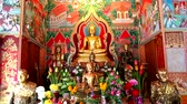 alms : Buddha and monk model in Nong Kead Yai Temple Stock Footage