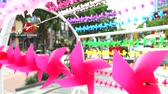 moinho : pink windmill toy is decorated at shopping mall rainbow wingmill background