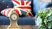 çalar saat : clock interior decorate object stand in living room and blur sofa bed background Stok Video