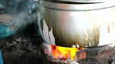 kaynama : Cooking using charcoal stoves is a way of rural people