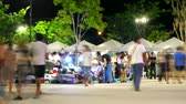 夜遊び : blur of people are shopping in night market and relax in the weekend 動画素材